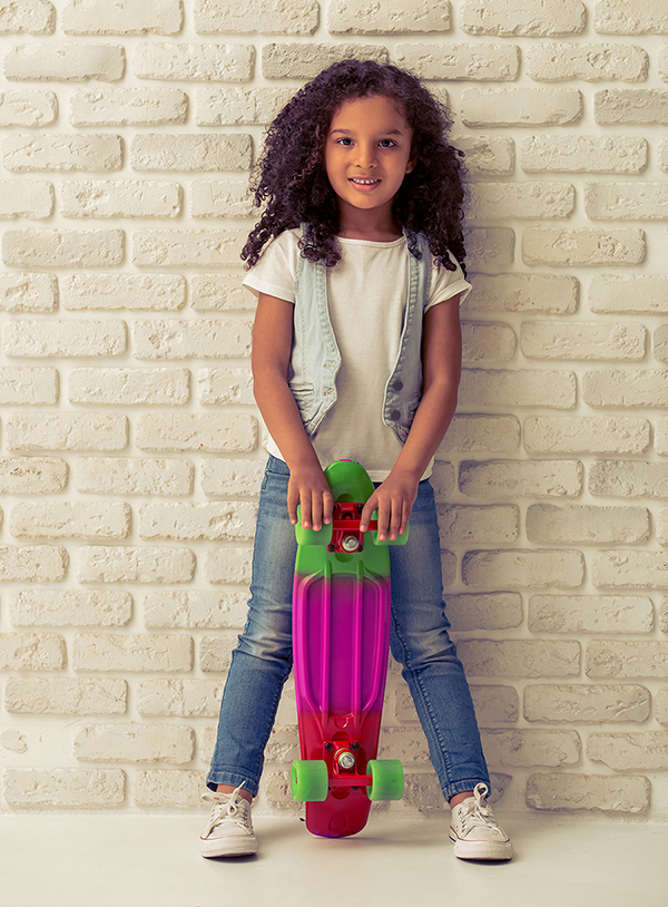 young girl holding a skateboard